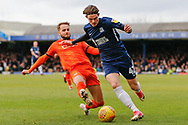 Luton Town midfielder Andrew Shinnie (11) tackles Southend United defender Sam Hart (42) during the EFL Sky Bet League 1 match between Southend United and Luton Town at Roots Hall, Southend, England on 26 January 2019.