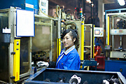 Workers operate on the production floor of a rubber products factory in Wux, Jiangsu iProvince, China on 14 December  2012.  The performance of the Chinese manufacturing sector is increasingly becoming a key indicator for the health of the world economy as a whole.