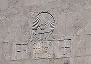 The Eye of Providence, the all-seeing eye of God, with the Italian inscription Dio Vede Tutto, God sees everything carved on the stone wall of Shkodër Cathedral, Katedralja e Shkodrës, St Stephen's Catholic Cathedral, Kisha e Madhe, the Great Church. Shkodër, Albania. 02Sep15
