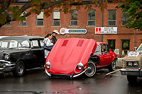 Showing of the old beauties along Beacon St West during Pumpkin Fest Saturday.  (Karen Bobotas/for the Laconia Daily Sun)
