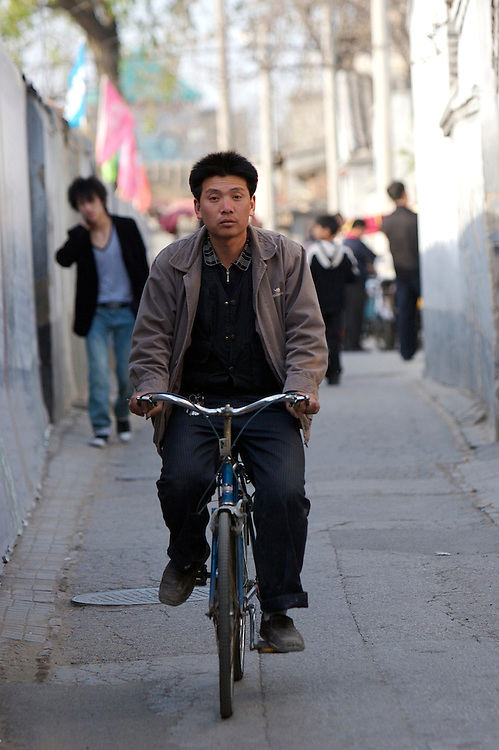 A biker travels through the Shichahai area of Beijing,China, which is cluttered with small alleyways and paths.