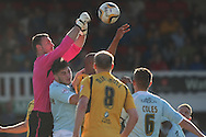 Exeter goalkeeper Artur Krysiak punches the ball clear. Skybet football league two match, Newport county v Exeter city at Rodney Parade in Newport, South Wales on Sunday 16th March 2014.<br /> pic by Mark Hawkins, Andrew Orchard sports photography.