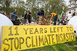 London, UK. 23rd April 2019. Climate change activists from Extinction Rebellion address an assembly in Parliament Square prior to the preparation of letters for delivery to their Members of Parliament.