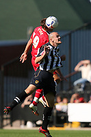 Photo: Pete Lorence.<br />Notts County v Swindon Town. Coca Cola League 2. 23/09/2006.<br />Michael Pook sends over Matt Somner's head.