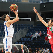 Anadolu Efes's Sasha Vujacıc (L) during their Turkish Basketball League Play Off match Anadolu Efes between Pinar Karsiyakaat Sinan Erdem Arena in Istanbul, Turkey, Sunday, May 06, 2012. Photo by TURKPIX