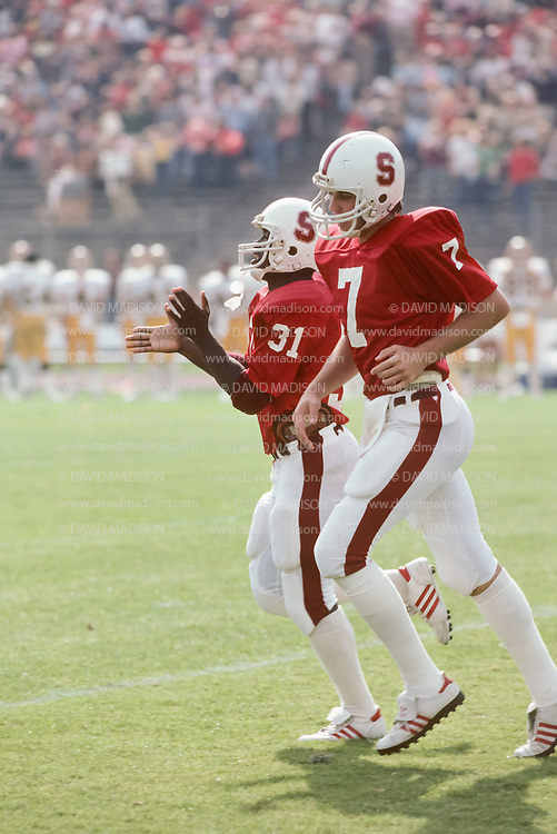 PALO ALTO, CA - OCTOBER 24:  Quarterback John Elway #7 of the Stanford Cardinal plays in an NCAA Pacific-10 football game against the Arizona State Sun Devils on October 24, 1981 at Stanford Stadium in Palo Alto, California.