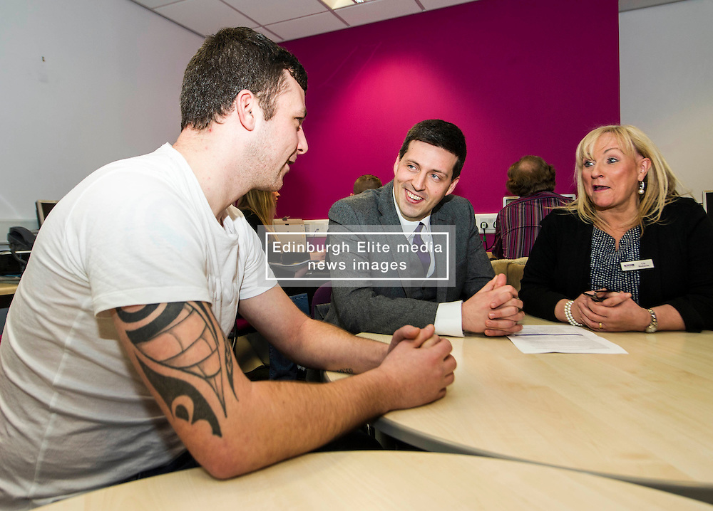 Pictured: Jamie Hepburn meets Ryan Muir and Liz Roberts<br /> <br /> Today, Minister for employability and training, Jamie Hepburn MSP visited Remploy in Edinburgh where he announced new employment services funding. Mr Hepburn gave details on cash which will develop new ways of supporting the Scottish Government's new devolved employment services. <br /> <br /> Ger Harley   EEm 21 December 2016