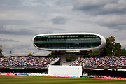"Lord's Cricket Ground during a test between England and India. Lord's Cricket Ground (generally known as Lord's) in St John's Wood, London. Named after its founder, Thomas Lord, it is owned by Marylebone Cricket Club (MCC) and is the home of Middlesex County Cricket Club, the England and Wales Cricket Board (ECB), the European Cricket Council (ECC). Lord's is widely referred to as the ""home of cricket"".<br /> <br /> The Media Centre, designed by Future Systems, UK was commissioned in time for the 1999 Cricket World Cup and was the first all aluminium, semi-monocoque building in the world. The lower tier of the centre provides accommodation for over 100 journalists and the top tier has radio and television commentary boxes. The centre's only opening window is in the broadcasting box used by Test Match Special. The Building was awarded the RIBA Stirling Prize for architecture in 1999."