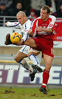 Photo: Ed Godden.<br /> <br /> Leyton Orient v Carlisle United. Coca Cola League 2. 11/02/2006. left, Adam Murray (Carlisle) challenges, Joe Keith (Leyton Orient)