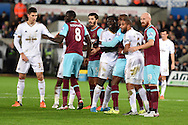 the players tussle for space in the box before a Swansea city corner is taken.Barclays Premier league match, Swansea city v West Ham Utd at the Liberty Stadium in Swansea, South Wales  on Sunday 20th December 2015.<br /> pic by  Andrew Orchard, Andrew Orchard sports photography.