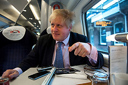 © London News Pictures. 15/04/2016. Manchester, UK. 15/04/2016. Boris Johnson during an interview while on a train ride to Manchester for an EU Out camping rally. . Photo credit: Ben Cawthra . Photo credit: Ben Cawthra/LNP