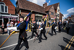 © Licensed to London News Pictures. 10/07/2020. London, UK. Pallbearer march through the town of Ditchling, East Sussex, to pay their respects ahead of the funera of Dame Vera Lynnl. The 'Forces' Sweetheart', who died last month aged 103, was famous for singing performances during WW2, which helped raise morale amongst troops abroad. Photo credit: Ben Cawthra/LNP