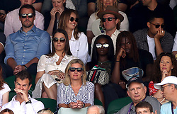 Amber Le Bon (centre left), Leomie Anderson and Lancey Foux (centre right) and Dougie Poynter and Maddy Elmer (centre back) in the stands on centre court on day one of the Wimbledon Championships at the All England Lawn Tennis and Croquet Club, Wimbledon.