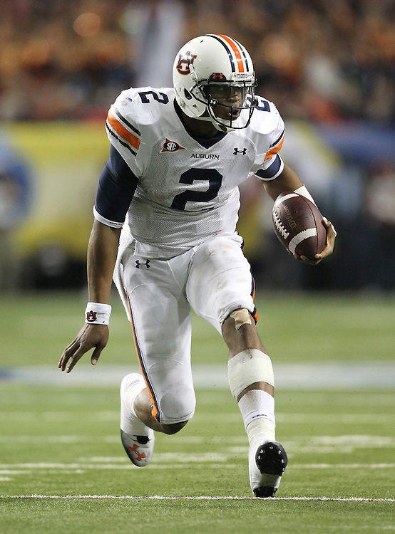 ATLANTA - DECEMBER 04:  Quarterback Cam Newton #2 of the Auburn Tigers runs with the ball during the 2010 SEC Championship against the South Carolina Gamecocks at Georgia Dome on December 4, 2010 in Atlanta, Georgia.  (Photo by Mike Zarrilli/Getty Images)