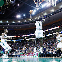 04 January 2013: Boston Celtics power forward Kevin Garnett (5) grabs a rebound next to Boston Celtics point guard Rajon Rondo (9) and Boston Celtics point guard Avery Bradley (0) during the Boston Celtics 94-75 victory over the Indiana Pacers at the TD Garden, Boston, Massachusetts, USA.