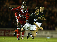 The FA Barclays Premiership<br />1 January 2005, The Riverside, Stadium, Middlesbrough<br />Middlesbrough v Manchester United<br />Manchester United's Roy Keane is challenged by Middlebrough's Jmmy Floyd Hasselbaink during the 2-0 win for Manchester United. Roy Keane was praised for hid superb performance in the win that keeps their title challenge alive<br />Pic Jason Cairnduff/Back Page Images