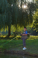 Young fisherman at the Allier. Pont-du-Chateau, Auvergne, France.