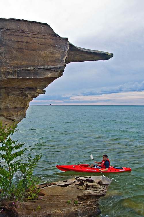 Sea kayaking on Lake Huron in the Point Aux Barques area near Port Austin Michigan.