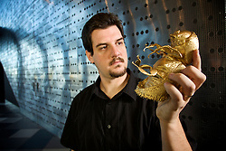 """Dr Paul Tafforeau, from the European Synchrotron Radiation Facility in France holding a replica of his newly discovered  ancient Australian wood beetle<br /> <br /> For the first time Paul has been able to construct exact replicas of these ancient organisms using synchrtron  imaging techniques to discover an array of new species.  These techniques have opened up the world of paleontology so that details of many fossilised  organisms  previously locked inside dense rock matrix  can now be revealed. This technique does not destroy the precious fossils and allows reconstruction of the missing body parts to reveal extrodinary details of both the internal and external structures of the organism and hence provide more information on the animals life history.  Because of this synchrtron technique many more fossilised oganisms will be idenified and classified than has occured in the past 50 years.The Australian Synchrotron  is commissioning an imaging and medical beamline that will one day  provide this sophisticated information to paleontologist and to medical researchers.<br /> <br /> Dr Paul Taffereau is a guest speaker at the 10th International conference on Synchrotron Radiation Instrumentation (SRI09)  being held at the new Melbourne Convention and Exhibition Centre this week (27 September -   2nd October. )  Paul also spoke  at a  public lecture entittle """"Seeing into the past with synchrtron light"""" at the Melbourn Museum on Tuesday 27 September, 2009."""