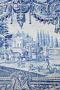 Historical azulejos, the blue-glazed ceramic tilework famous in the area, depict the fables of La Fontaine. Seen here in the vast collection at the Monastery of Sao Vicente de Fora, Lisbon, Portugal