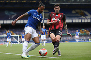 Everton forward Theo Walcott (11) and Bournemouth defender Diego Rico (21) during the Premier League match between Everton and Bournemouth at Goodison Park, Liverpool, England on 26 July 2020.