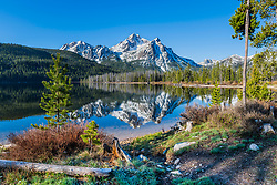 Path to Stanley Lake Mount McGowen rising above casting a reflection upon the lake in the Sawtooth National Recreation Area near Stanley Idaho.