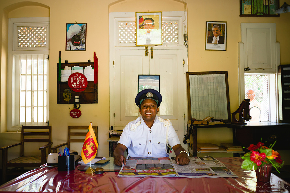 The smiling Station Master inside his office at a station on the  Kandy to Badulla Railway Line in Sri Lanka, Kandy to Badulla Railway Line, Colombo, Sri Lanka