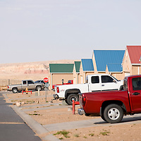 040113       Brian Leddy<br /> Two females walk in Chilchenbito Estates near Chilchenbito, Ariz. Monday afternoon. Most of the homes in the neighborhood are occupied, unlike the similar Shiprock housing development, which has fallen into ruin.