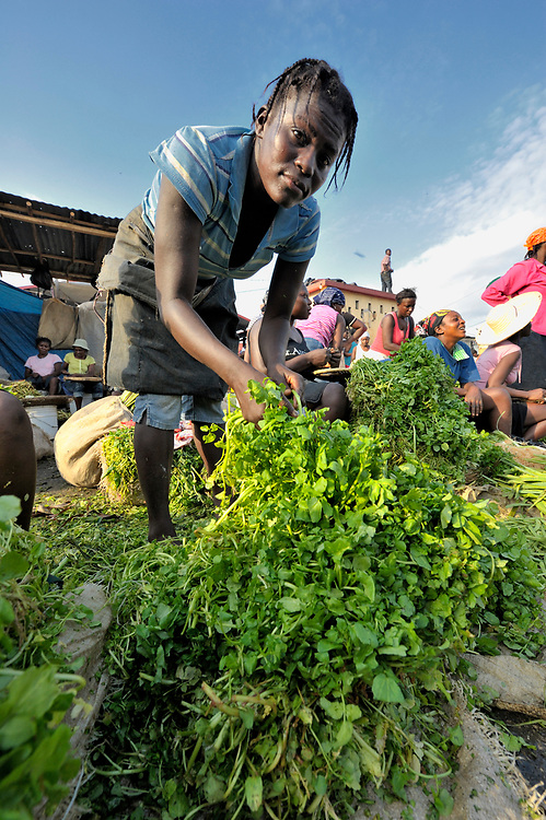 A woman sells produce in the Croix-des-Bossales market in the La Saline neighborhood of Port-au-Prince, Haiti.