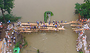 YANGZHOU, CHINA - JULY 06: <br /> <br /> Aerial view of villagers walking on boards in Yizhengxinji Town which is flooded as a dyke bursts due to heavy rainstorm on July 6, 2016 in Yangzhou, Jiangsu Province of China. Heavy rainstorm continued in southern China which affected local residents\' whole way of life. <br /> ©Exclusivepix Media