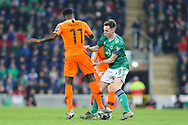 Northern Ireland midfielder Gavin Whyte (18) and Netherlands forward Quincy Promes (11) during the UEFA European 2020 Qualifier match between Northern Ireland and Netherlands at National Football Stadium, Windsor Park, Northern Ireland on 16 November 2019.