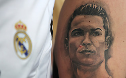 A Real Madrid fan with a Cristiano Ronaldo fan in the stands