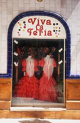 Viva La Feria  Flamenco dresses displayed in shop window; Malaga,