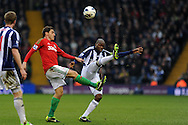 Swansea city's Angel Rangel (l) battles for the ball with WBA's Youssouf Mulumbu (r). Barclays Premier league, West Bromwich Albion v Swansea city at the Hawthorns stadium in West Bromwich, England on Saturday 9th March 2013.  pic by  Andrew Orchard, Andrew Orchard sports photography,