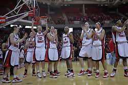 29 March 2009: The Redbirds gather in front of the band and student section still celebrating as they wait to sing the Redbird Fight Song at the games conclusion. The Hoosiers of Indiana fall to the Redbirds of Illinois State 66-55 during a Women's National Invitational quarterfinal game on Doug Collins Court inside Redbird Arena in Normal Illinois.