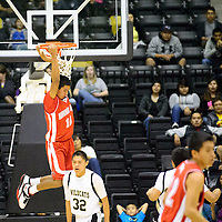 021214  Adron Gardner/Independent<br /> <br /> Redmond Delmar (10) hangs on the rim after performing a slam dunk on the Chinle Wildcats in Chinle Wednesday.