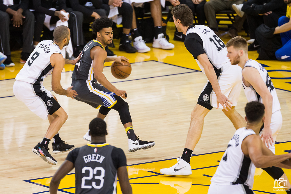 Golden State Warriors guard Quinn Cook (4) handles the ball against the San Antonio Spurs during Game 2 of the Western Conference Quarterfinals at Oracle Arena in Oakland, Calif., on April 16, 2018. (Stan Olszewski/Special to S.F. Examiner)