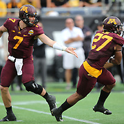 ORLANDO, FL - JANUARY 01: Mitch Leidner #7 of the Minnesota Golden Gophers hands the ball off to David Cobb #27 during the Buffalo Wild Wings Citrus Bowl against the Missouri Tigers at the Florida Citrus Bowl on January 1, 2015 in Orlando, Florida. (Photo by Alex Menendez/Getty Images) *** Local Caption *** Mitch Leidner; David Cobb