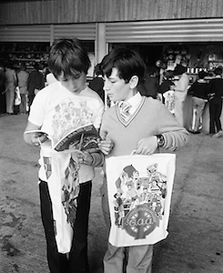 Two boys look at a brouchure on their visit to Croke Park during a Kells Educational Tour on the 12th of June 1975.