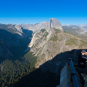 Tourists enjoy Half Dome view from Glacier Point, Yosemite National Park, California