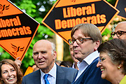 Guy Verhofstadt, Leader of the Alliance of Liberals and Democrats for Europe Party and the European Parliaments chief Brexit negotiator center speaks to the media during a European Parliament elections campaign event with Liberal Democrat leader Sir Vince Cable left and party activists before canvassing for support for their candidates in the forthcoming European elections, on 10th May 2019 in Camden, North London, England, United Kingdom. Sir Vince Cable said the partys message was to stop Brexit.