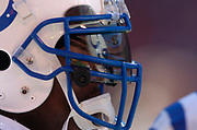 A reflection of Arrowhead Stadium and Indianapolis Colts teammates in facemask visor of Mike Doss during AFC Divisional Playoff against the Kansas City Chiefs at Arrowhead Stadium in Kansas City, Mo. on Sunday, Jan. 11, 2004.