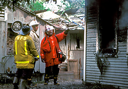Stock photo of Houston fire fighters assessing damages after a large fire burned multiple buildings