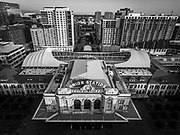 SHOT 8/28/18 6:52:28 AM - Aerial views of Denver Union Station. Denver Union Station is the main railway station and central transportation hub in Denver, Colorado. It is located at 17th and Wynkoop Streets in the present-day LoDo district and includes the historic terminal building, a train shed, a 22-gate underground bus facility, and light rail station. In 2012, the station underwent a major renovation transforming it into the centerpiece of a new transit-oriented mixed-use development built on the site's former railyards. The station house re-opened in the summer of 2014 as a combination of the 112-room Crawford Hotel, several restaurants and retailers, and the great hall. (Photo by Marc Piscotty / © 2018)