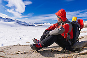 Backcountry skier enjoying the view from Piute Pass, Inyo National Forest, Sierra Nevada Mountains, California