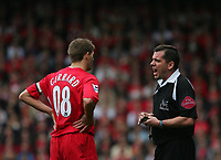 Photo: Andrew Unwin.<br />Liverpool v Everton. The Barclays Premiership. 25/03/2006.<br />Liverpool's Steven Gerrard (L) is booked for dissent by the referee, Phil Dowd (R).