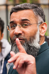 "London, April 18th 2014. Anjem Choudary (pictured) and his Islam4UK group protest after Friday prayers at Regent's Park Mosque, against ""Cameron's crusades"".///FOR LICENCING CONTACT: paul@pauldaveycreative.co.uk TEL:+44 (0) 7966 016 296 or +44 (0) 20 8969 6875. ©2015 Paul R Davey. All rights reserved."