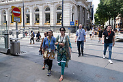 People out and about in the city centre shopping district in what was a positive atmosphere on the long awaited freedom day when all remaining coronavirus restrictions are lifted in the UK on 19th July 2021 in Birmingham, United Kingdom. While many people are wearing face masks, they are no longer mandatory, while government advice suggests that it is advised to wear a face covering in busy public places inside and on transport.