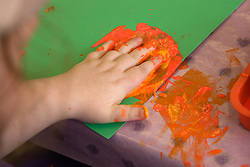 Day Service user with Learning disability hand painting,