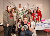 Jag students at Laconia High School duct taped Craig Kozens Athletic Director/Dean of Students to the wall to raise money for Make-A-Wish on Wednesday afternoon.  (l-r back row) Amie Paige, Jenna Dame, Mariah DeRoche, Craig Kozens, Savannah Hartman, Lucy Tully and Ryan Bond.  (l-r front row) Alyssa Bickford, Justin Holmes and Jordin Poire.  (Karen Bobotas/for the Laconia Daily Sun)